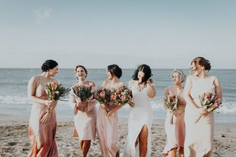 mismatching blush bridesmaid dresses and cool bouquets with king proteas