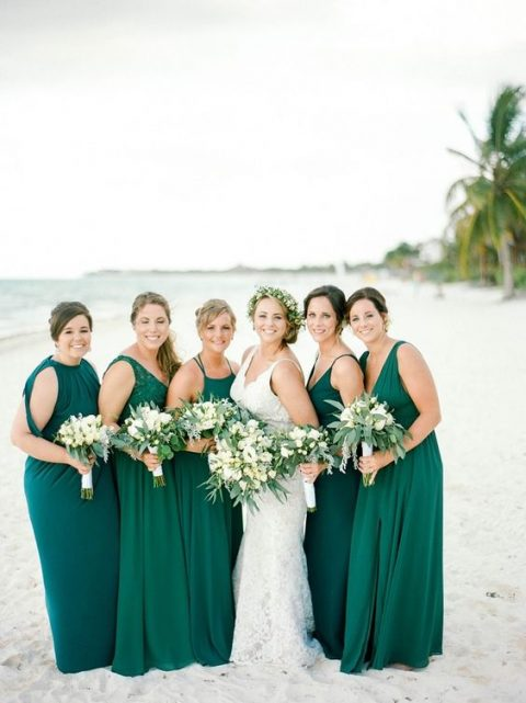 mismatching emerald maxi bridesmaid dresses and a teal one for the maid of honor