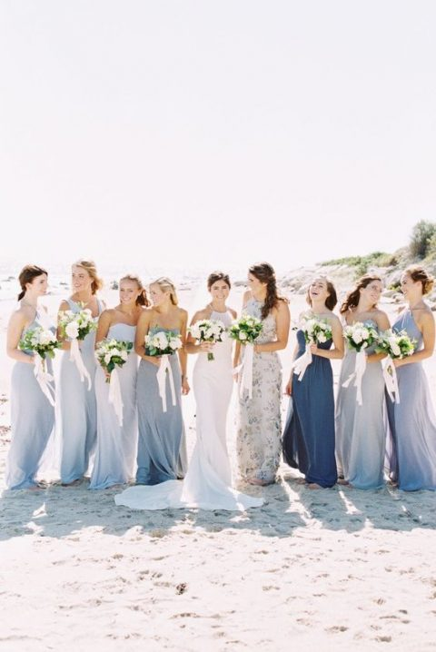mismatching maxi bridesmaid dresses in blue shades for a coastal wedding
