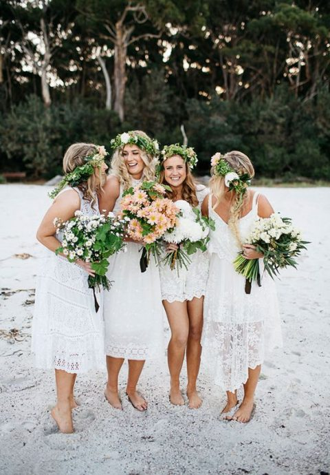 mismatching white lace bridesmaid dresses for a boho beach wedding