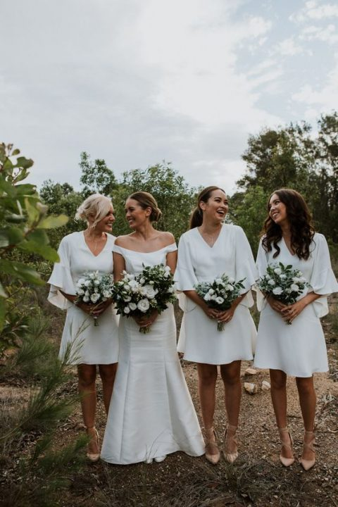 modern and simple white over the knee bridesmaid dresses with wide ruffle sleeves and V-necklines