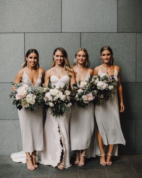 plunging neckline midi dresses with side slits are amazing for bridesmaids on a hot day