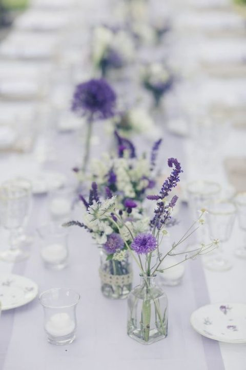 simple wildflower centerpieces in clear vases for a relaxed rustic wedding or a rehearsal dinner