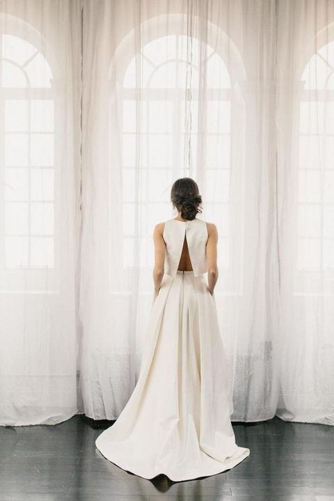 such a modern bridal separate with a crop top with an open back is a bold idea