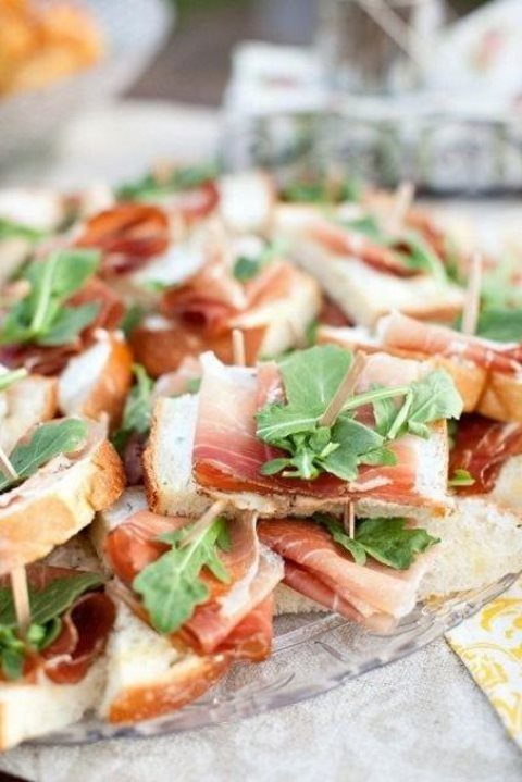 tasty sandwiches with prosciutto and fresh arugula are a hearty snack idea