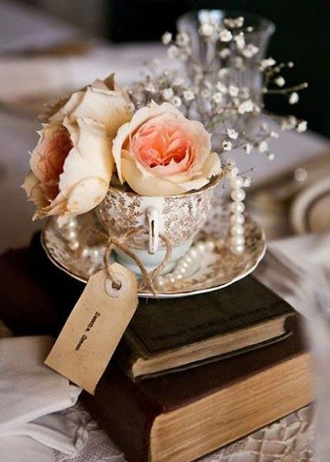 vintage books, a vintage teacup with pearls, blooms, baby_s breath and a tag