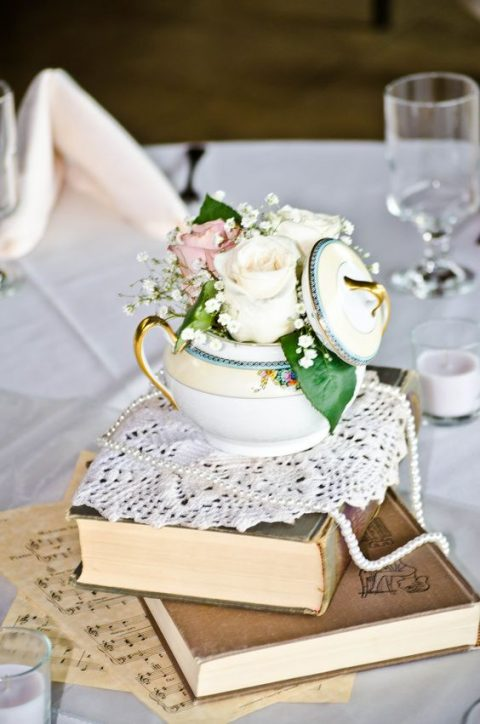 vintage books with a doily, pearls and a vintage sugar pot with roses and baby_s breath
