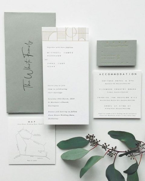 a chic and natural wedding invitation suite in olive green and white with black letters