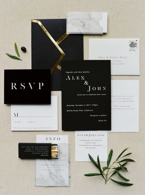 a chic modern black and white invitation suite with gold touches and marble prints