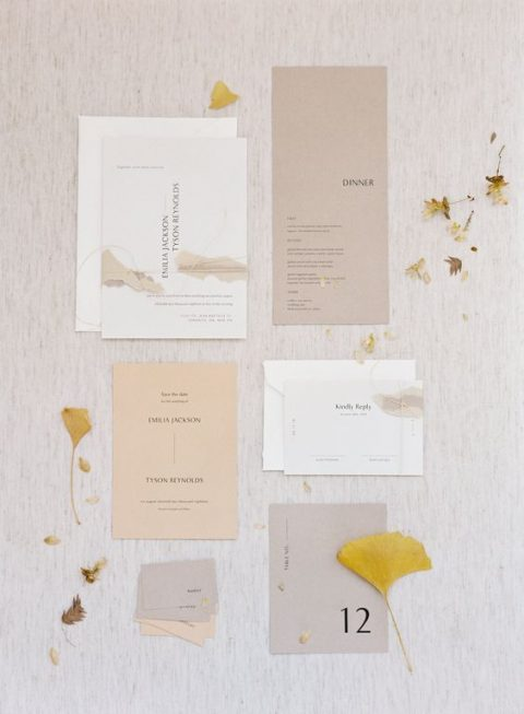 a contemporary and stylish wedding invitation suite in neutrals with blakc lettering