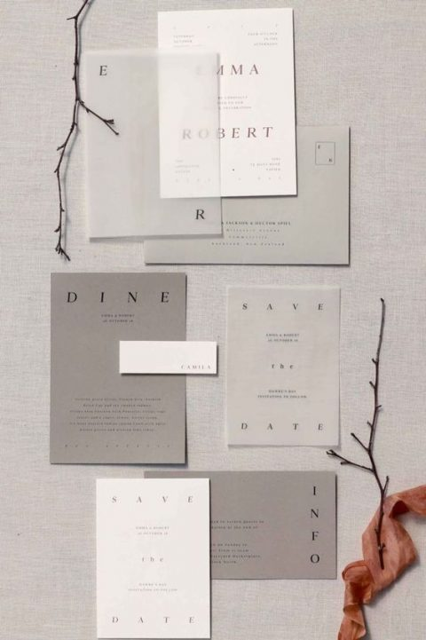 an ethereal modern wedding invitation suite in white and shades of grey