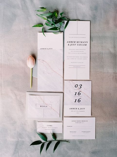 laconic blush marble wedding invites with black letters and numbers for a simple modern wedding