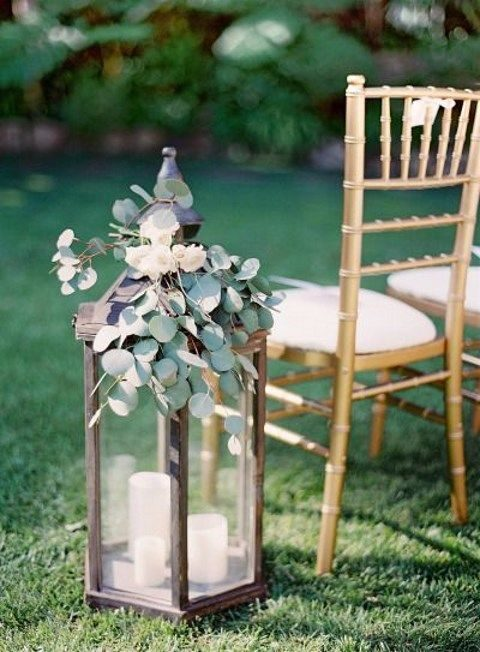 eucalyptus lantern decor for a wedding aisle