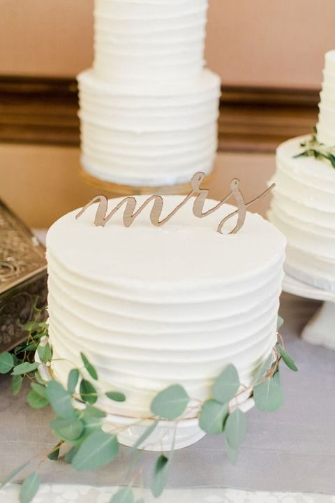 petite wedding cakes get dressed up with eucalyptus and sweet scripted toppers