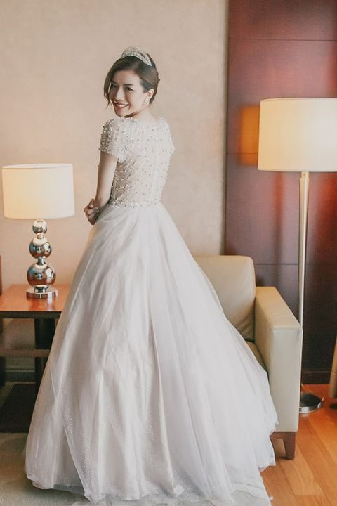 A Beautiful Cap Sleeved Wedding Gown With Embellished Bodice And Layered Tulle Skirt