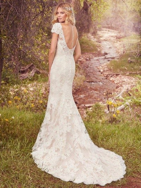 414e9ed1475 cutout back lace wedding dress with buttons and a small train