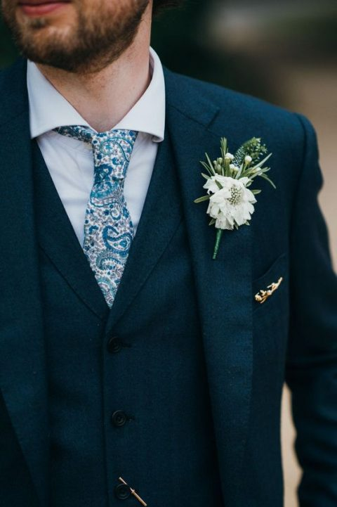 A Navy Three Piece Wedding Suit With White Shirt And Funky Printed Blue Tie