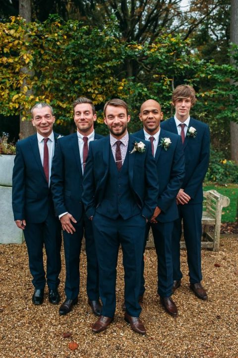 Three Piece Navy Wedding Suit With A Polka Dot Shirt And Burgundy Tie Brown Shoes