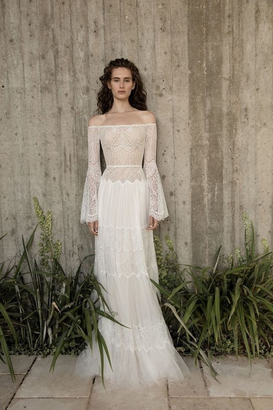 a5756d353df a romantic off the shoulder boho wedding dress with bell sleeves and a lace  semi sheer bbodice