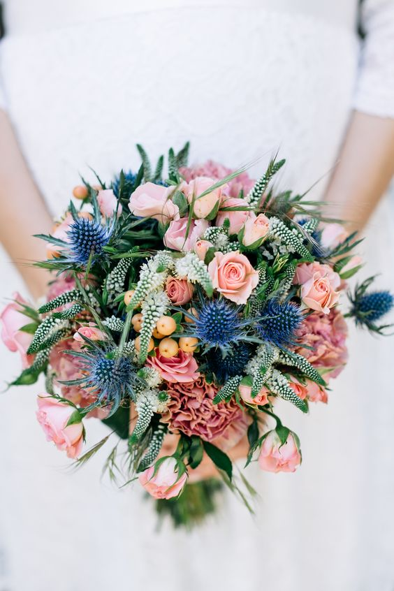 A Colorful Bouquet With Pink Blooms Blue Thistles And