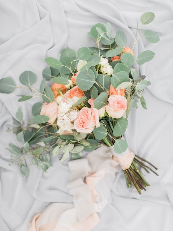 A Simple Wedding Bouquet With Blush And Orange Roses And
