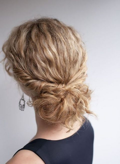 a low bun with straightened hair and locks down