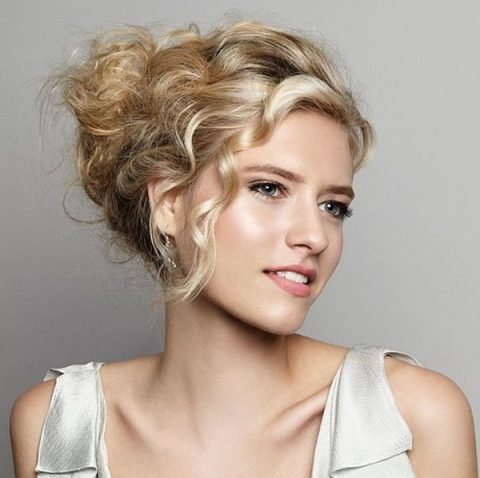 a messy updo with a chignon is an elegant and refined option