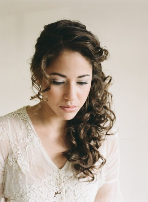 a side half updo with curls and bangs