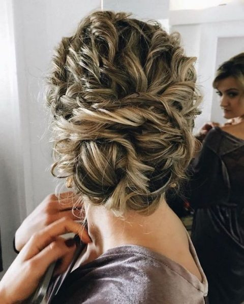 tie up your curly hair into a large twisted low bun, it will look very textural and messy